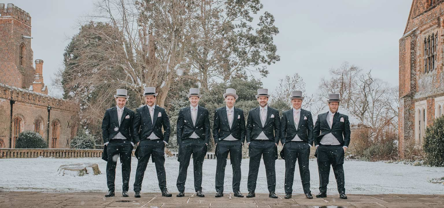Groom and his groomsmen in the snow