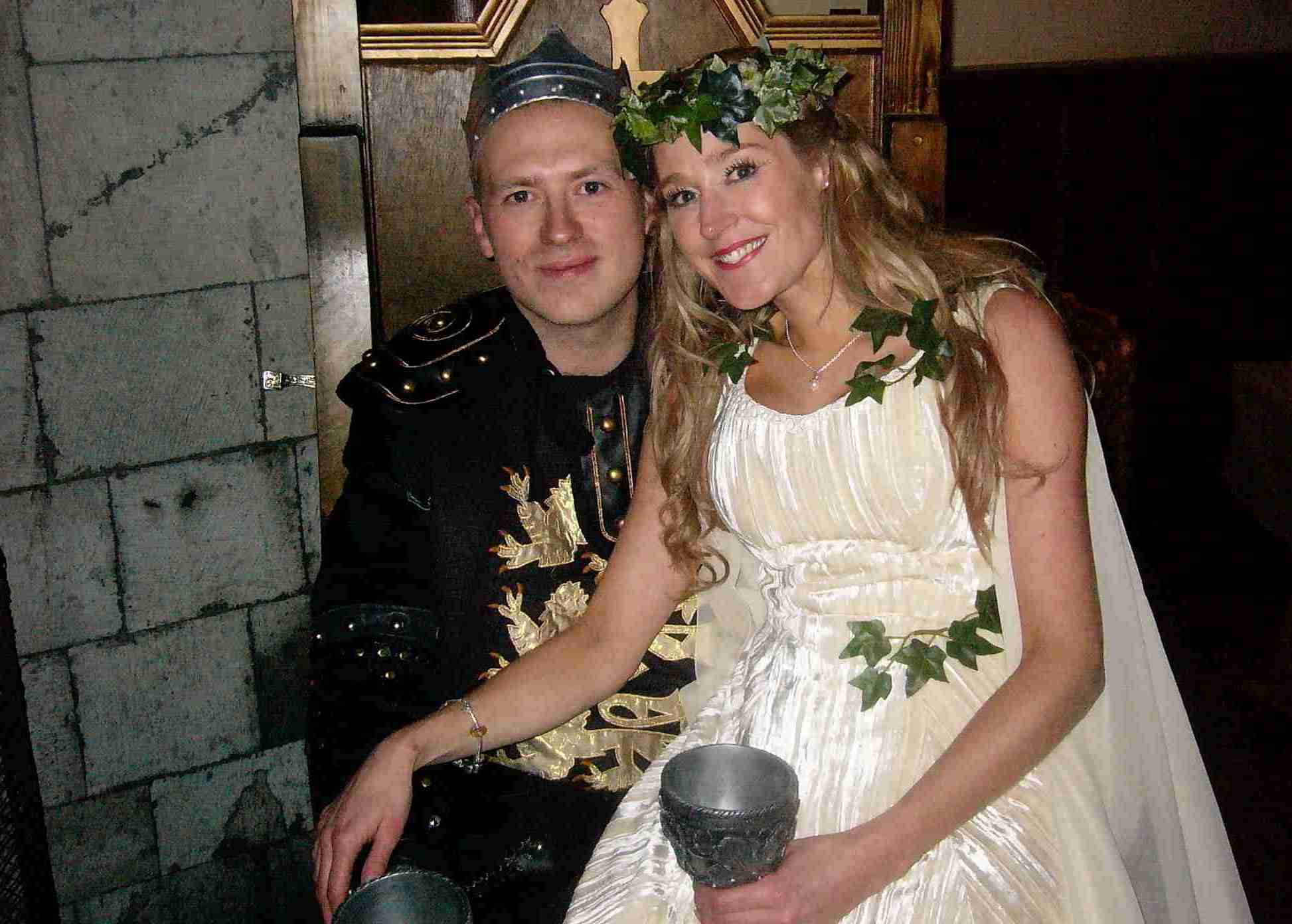 Bride and groom on throne, medieval costume