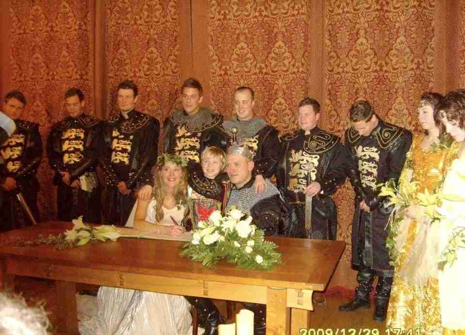Bride and groom with bridesmaids and groomsmen, medieval theme, ceremony room