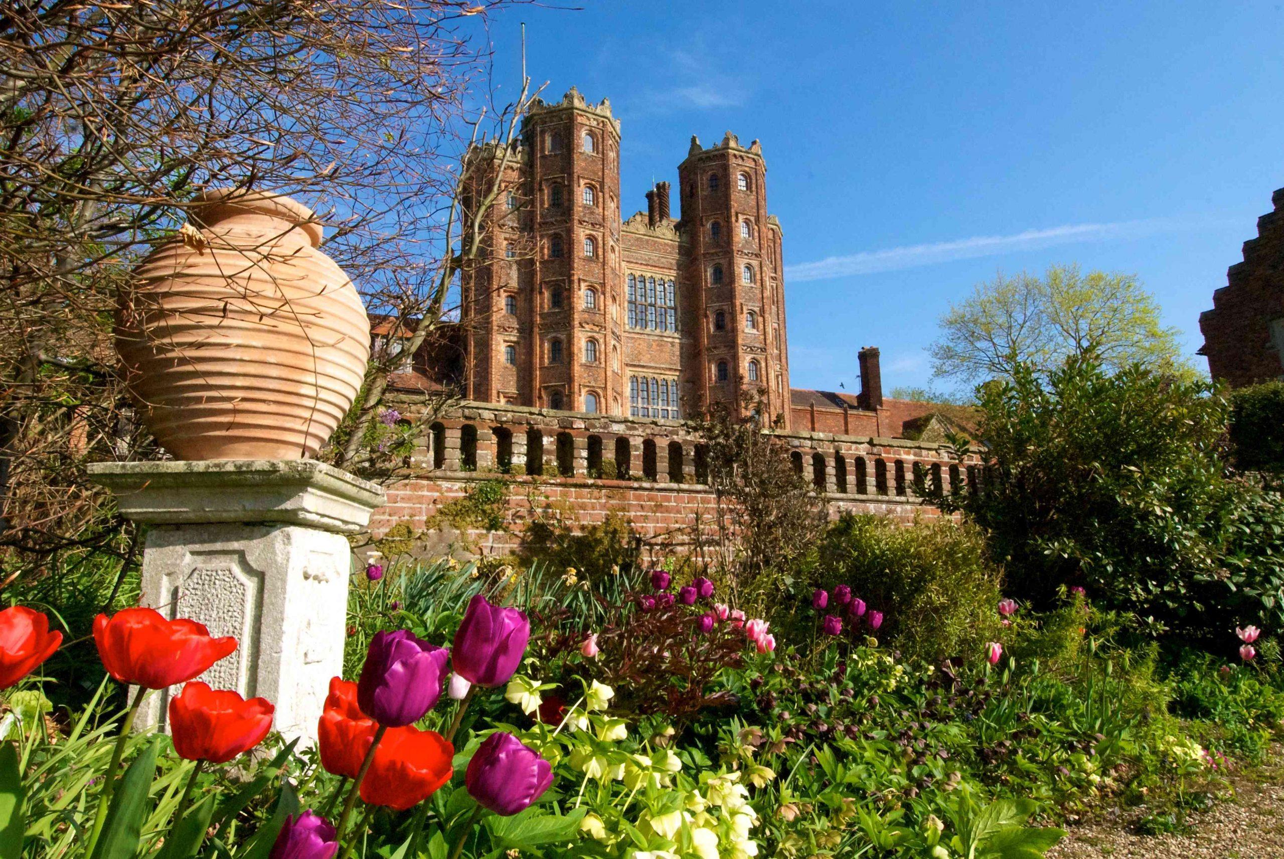 Historic house wedding venue, garden, tulips, Tudor building