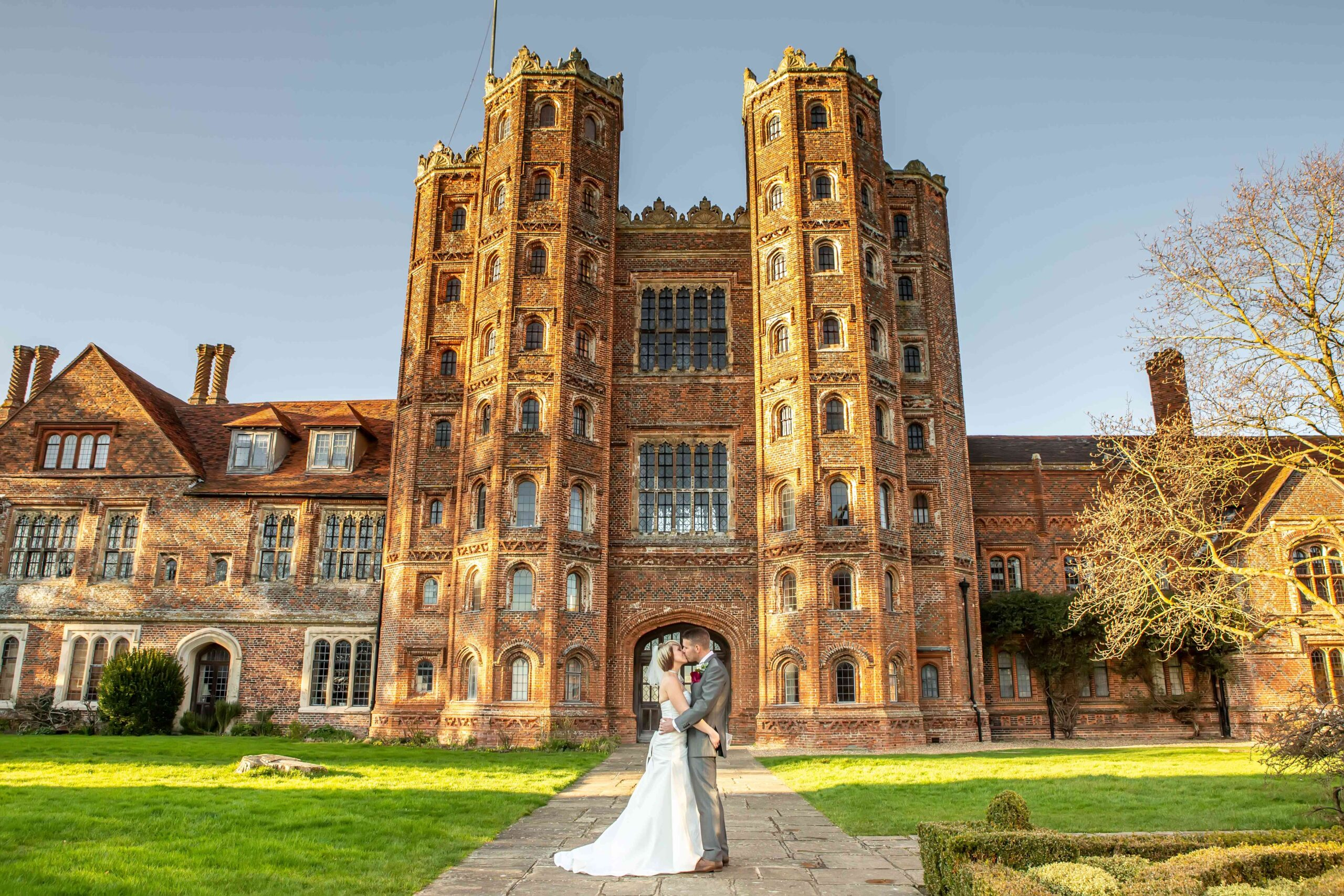 Wedding couple in front of Tudor tower