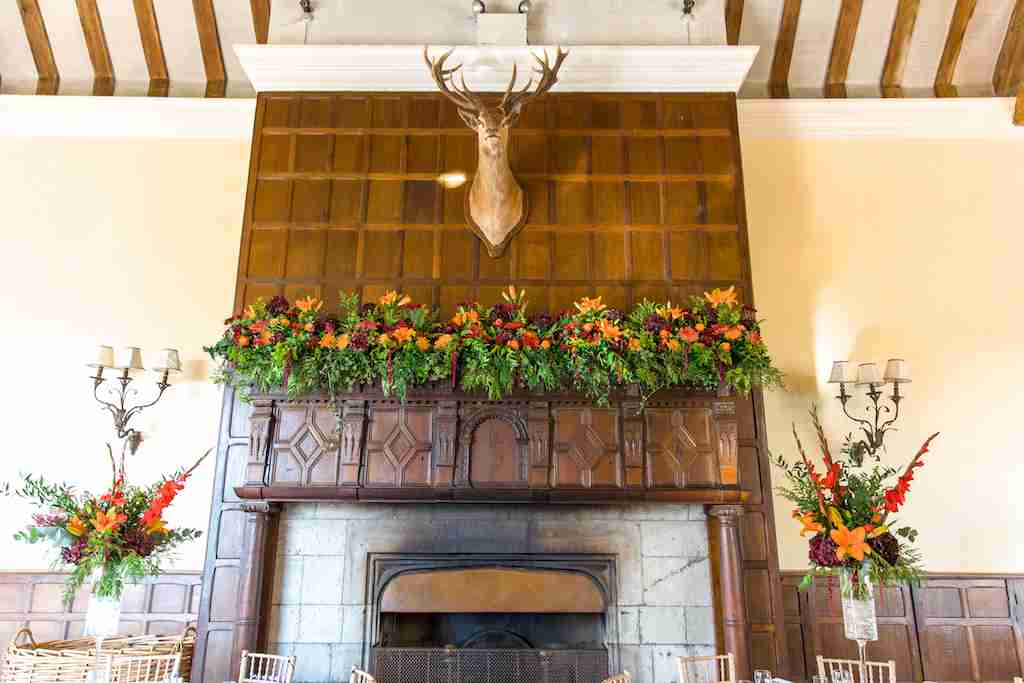 Fireplace decorated with flowers
