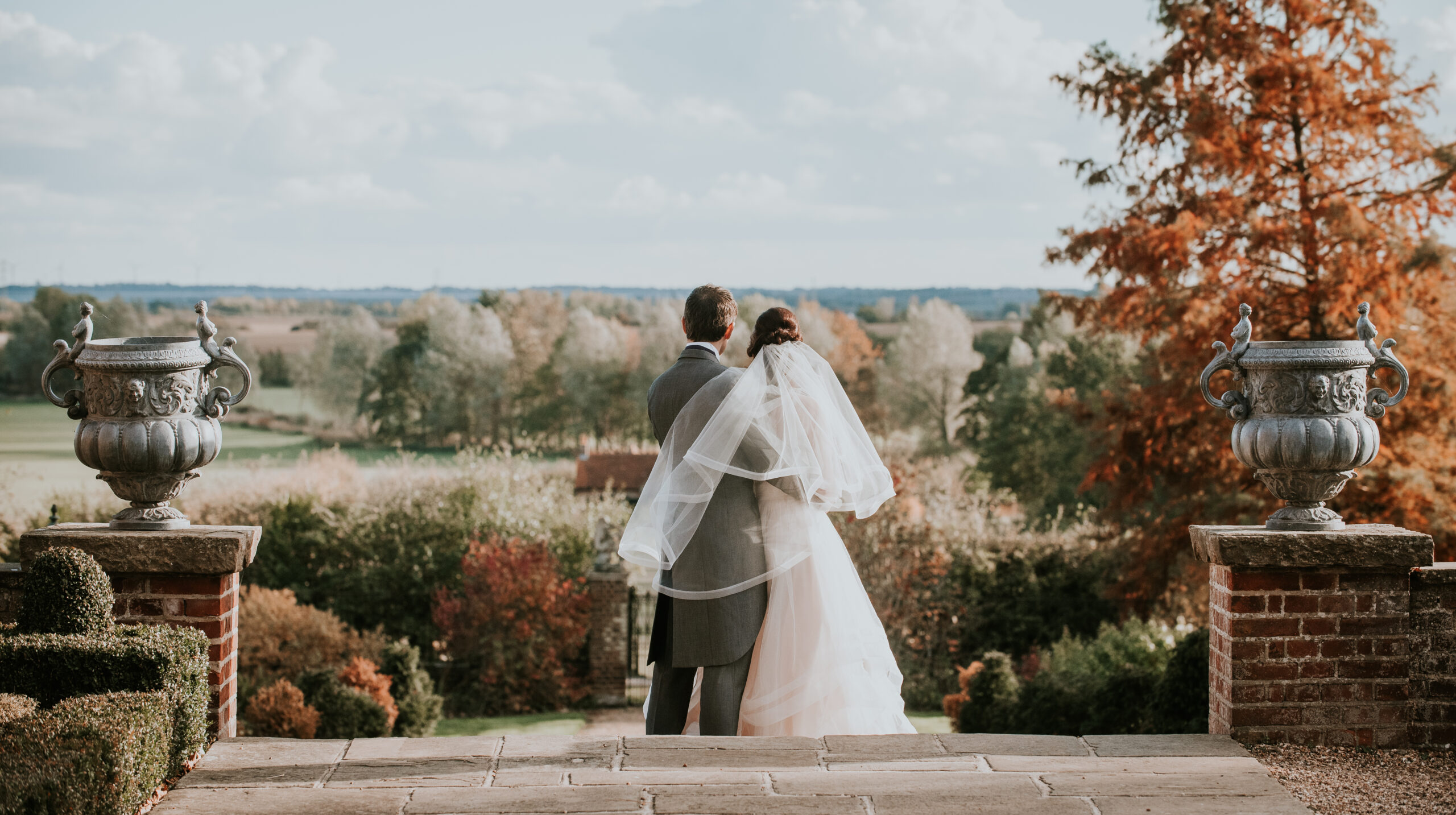 Bride and Groom looking at countryside view