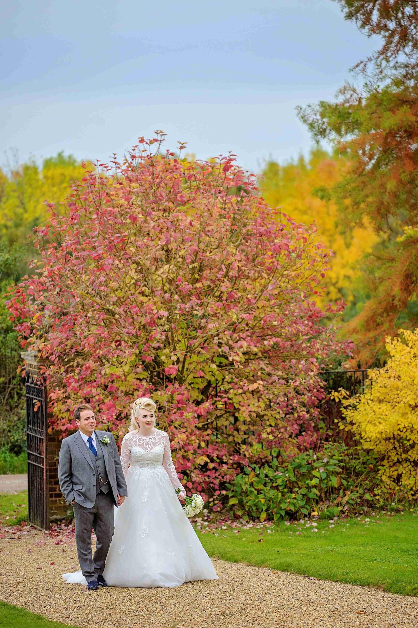 Autumn garden, bride and groom