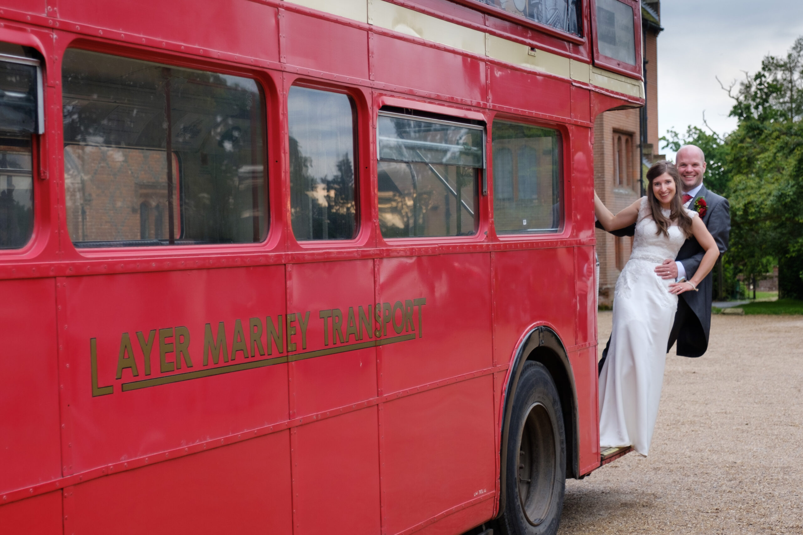 Bride and groom on London Routemaster wedding bus