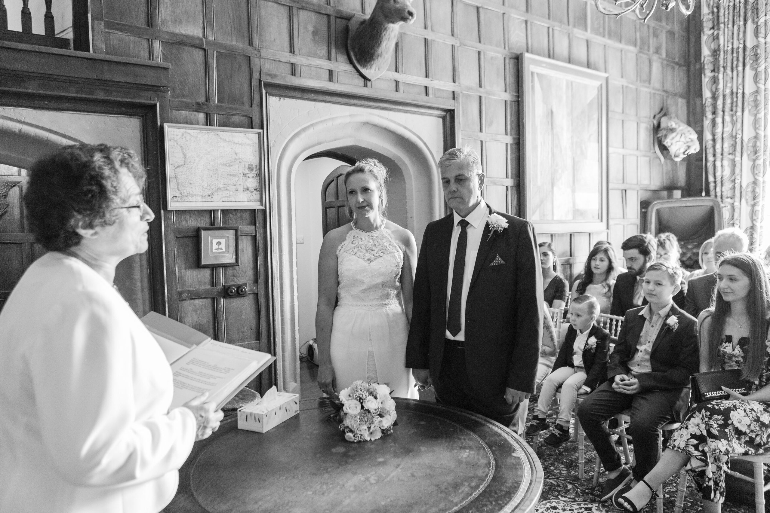 The registrar, bride and groom during the ceremony