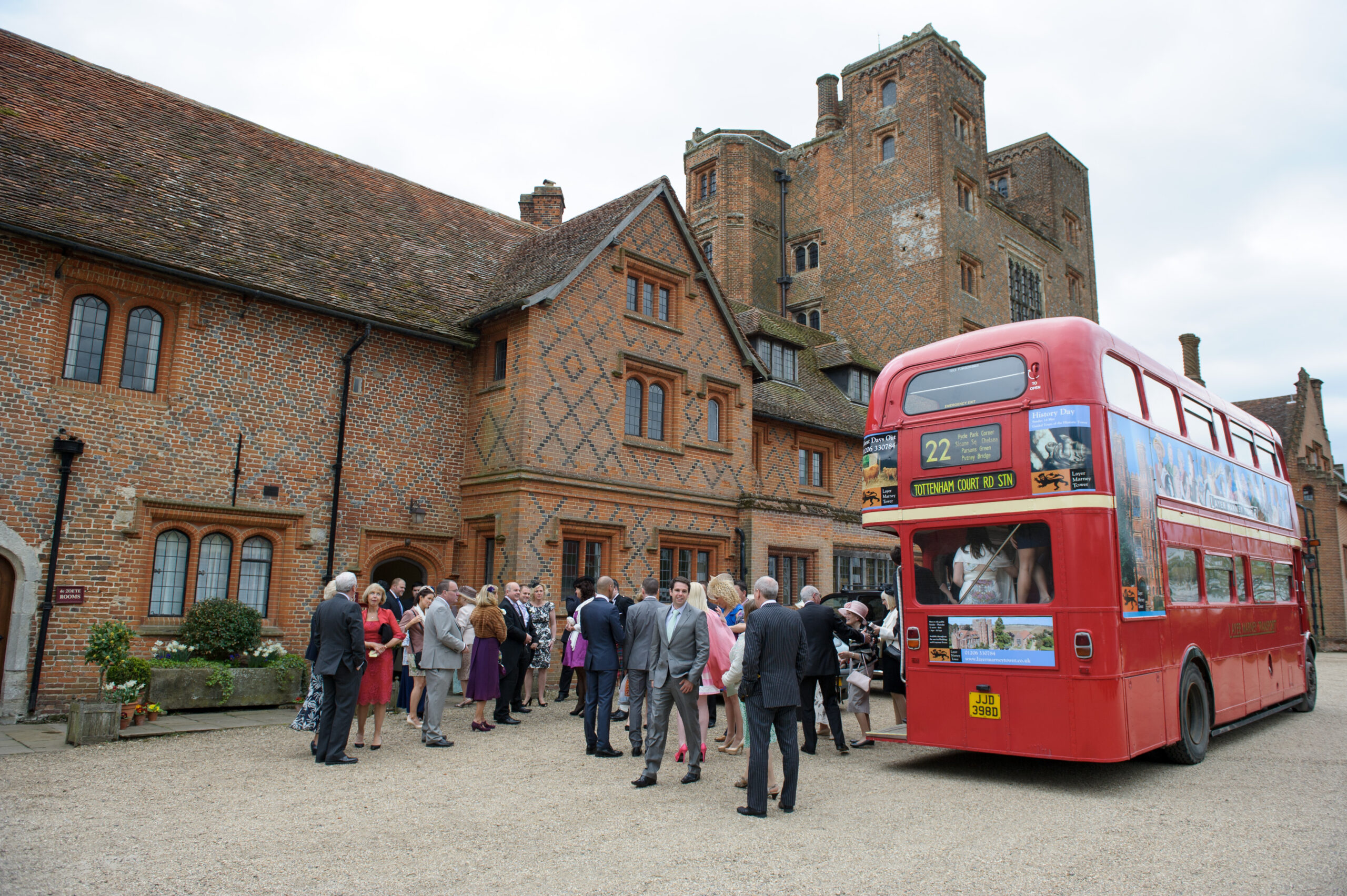 Wedding guests arriving on London Routemaster Bus