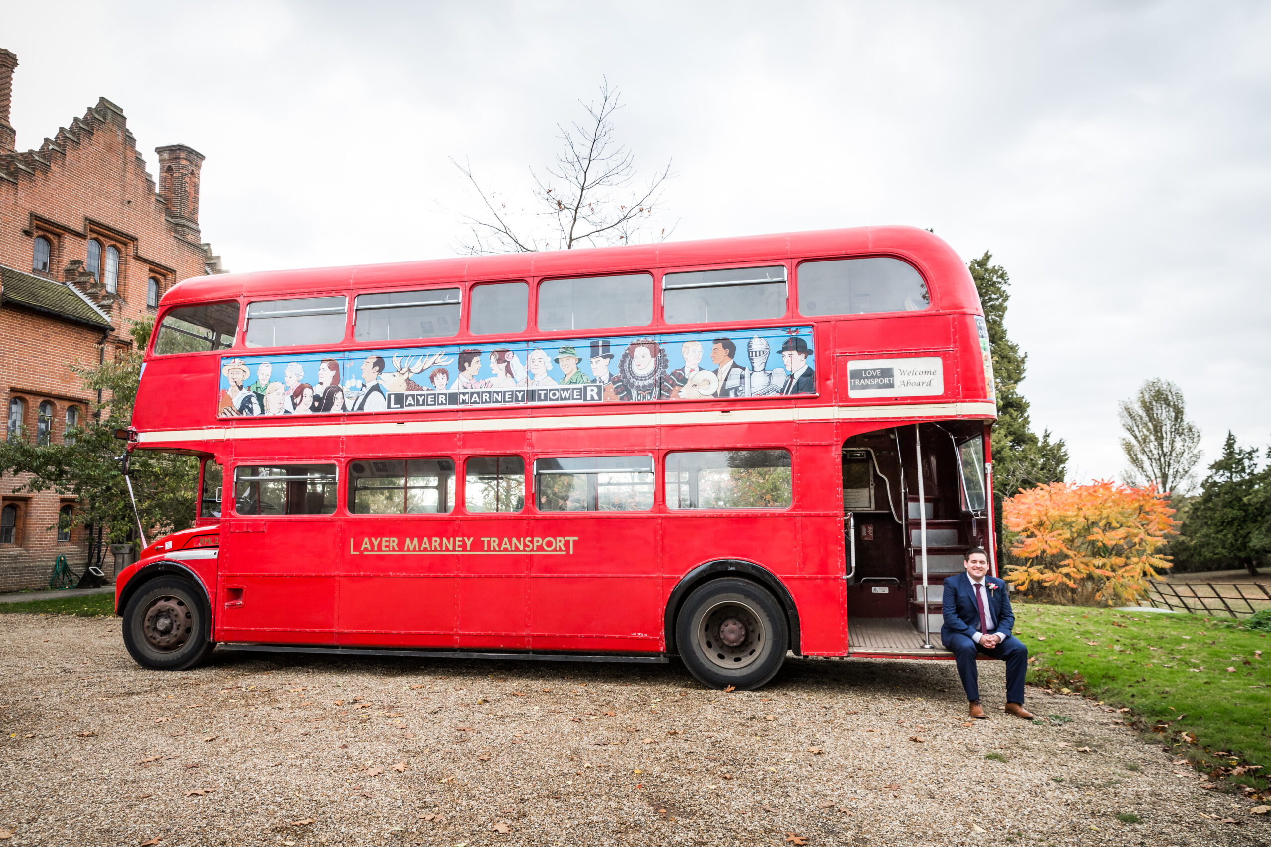 The groom sitting on the entrance to the bus
