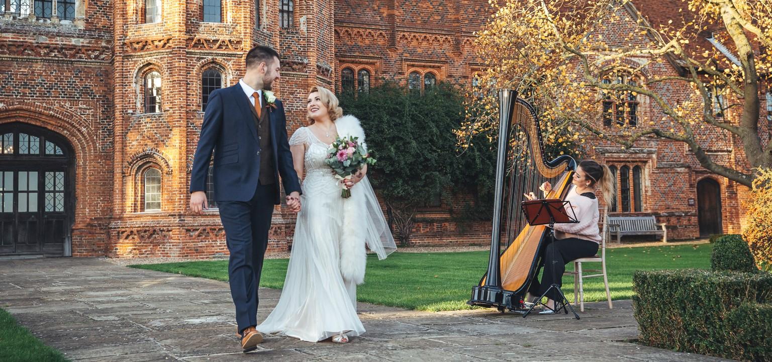 Bride and Groom in garden with harpist