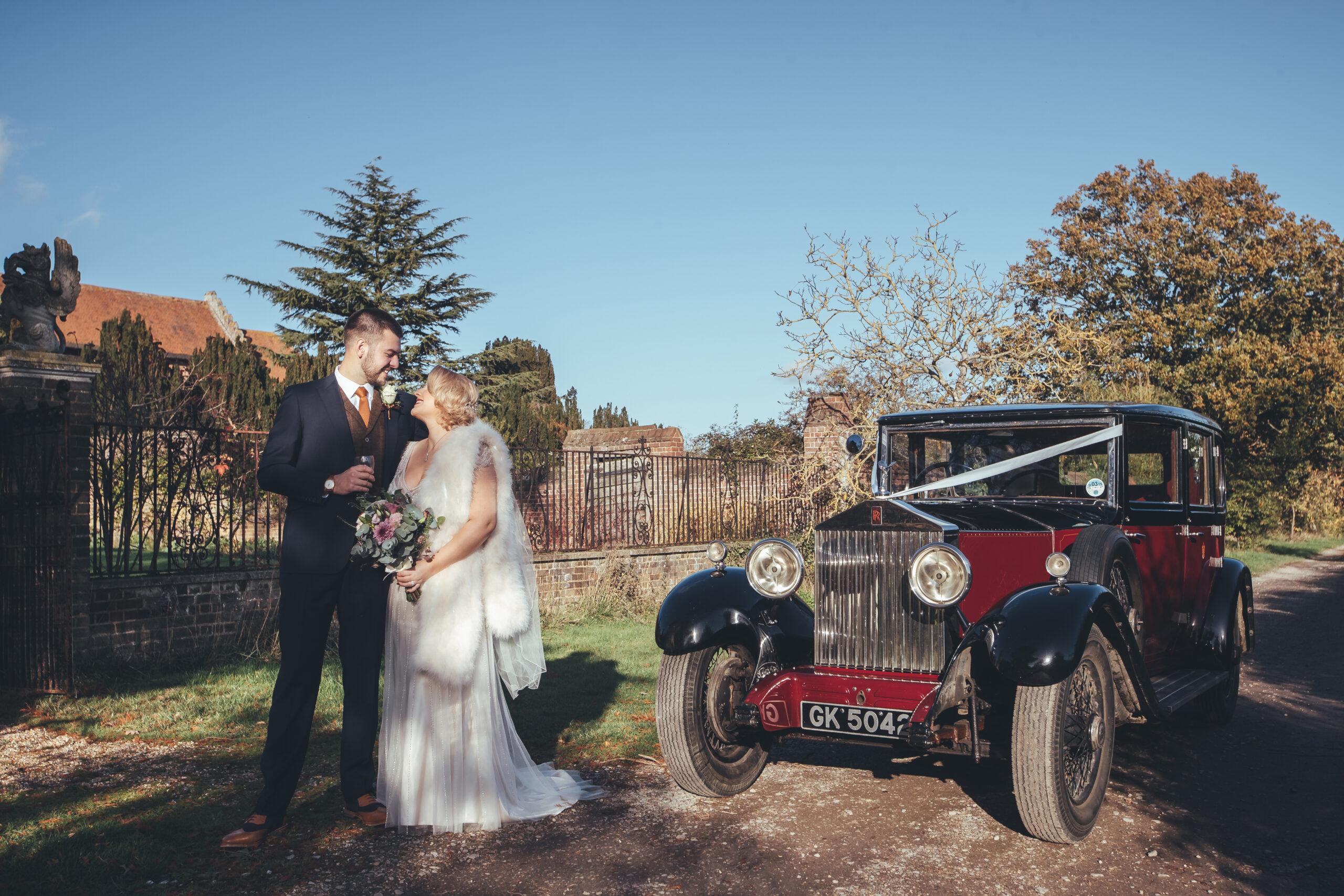 Bride and Groom with vintage Rolls Royce