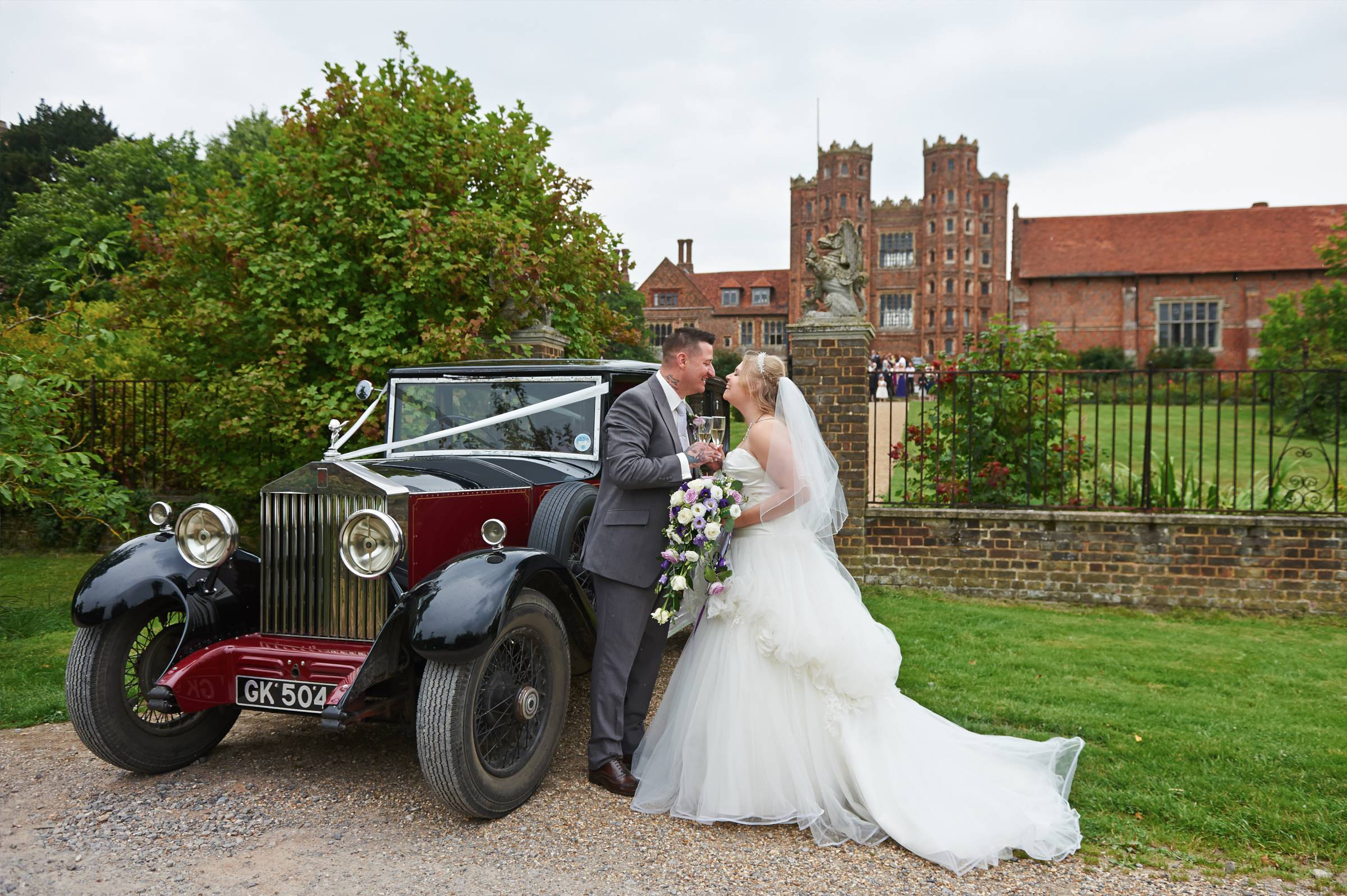 Bride and Groom with vintage Rolls Royce
