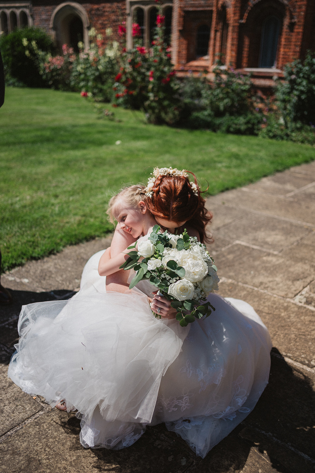 Bride and Flower girl cuddle